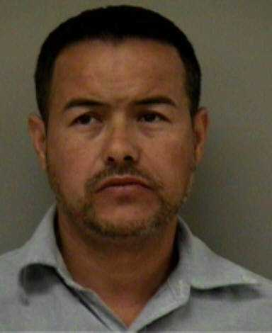 Juan Carlos Esparza, 39, was arrested during a traffic stop that led to the discovery of 18 kilograms of cocaine, 16 pounds of methamphetamine and eight pounds of heroin as well as $7,000 in cash, according to the Madera County Sheriff's Department.