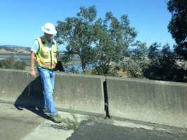 A Caltrans bridge inspector look at Highway 121/12 over the Napa River.