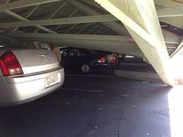 A collapsed carport damages vehicles at Charter Oaks Apartment in Napa.