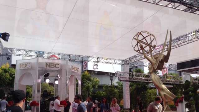 Crews prepare the red carpet at the 2014 Primetime Emmy Awards.