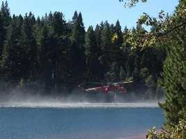 Fire crews were conducting water drops to fight the King Fire. (Sept. 15, 2014)