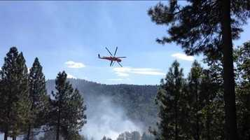 Helicopters drop water on the King Fire. (Sept. 15, 2014)