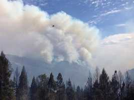 A plume of smoke rises from where the King Fire is burning in El Dorado County. (Sept. 15, 2014)