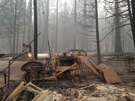 A burned-out tractor near homes that burned in the King Fire of Pollock Pines. (Sept. 19, 2014)