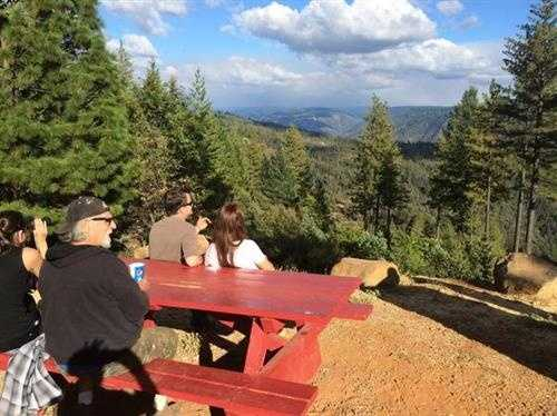 People at a picnic area watch smoke rise from the King Fire. (Sept. 19, 2014)