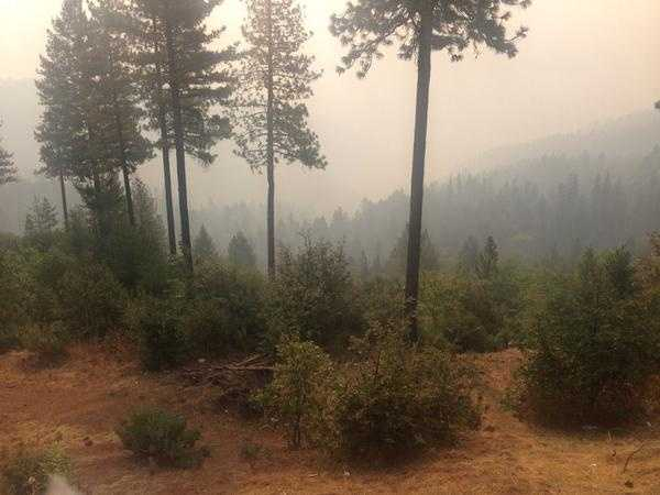 Crews battling the King Fire brace for hotter temperatures and erratic winds Monday.