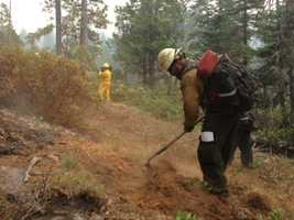 Crews continued battling the King Fire on Monday, which continues to burn and keep people out of their houses in El Dorado County. Air-quality concerns are becoming more and more prevalent, as well (Sept. 22, 2014).