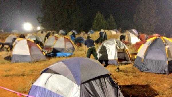 Crews stake their own tent camping areas. The camp area is bright and noisy, making it tough to get sleep.