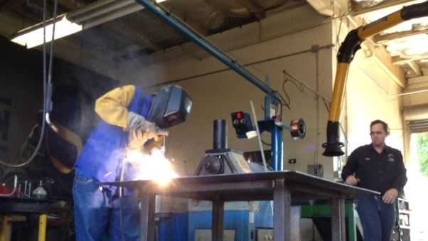David Statham attends a welding class at Yuba College in Marysville.