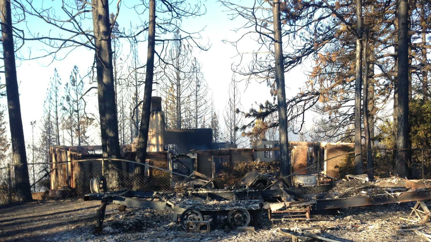 A series of small wildfires along Interstate 80 destroys five homes.