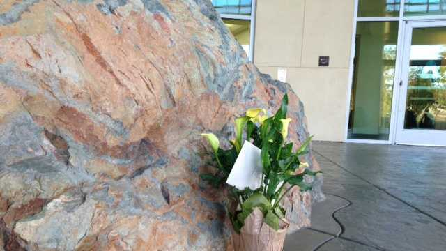 Flowers are left for the fallen Placer County sheriff's deputy. (Oct. 24, 2014)