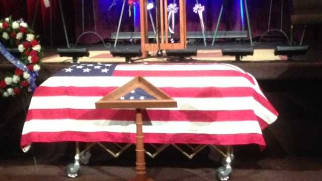 The U.S. Honor Flag sits in a display case in front of Sacramento County Sheriff's deputy Danny Oliver's casket.
