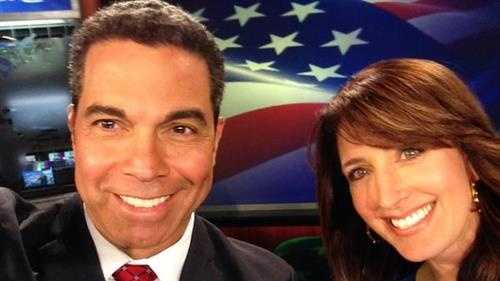 KCRA 3's Gulstan Dart and Edie Lambert take an election selfie as they anchor coverage in the studio with an American flag backdrop. (Nov. 4, 2014)