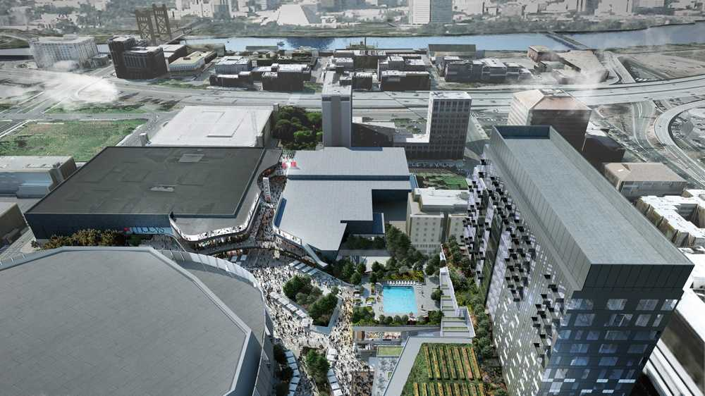 The Sacramento Kings released a new rendering Friday that shows new shopping venues and a hotel that will be built around the new downtown sports and entertainment complex. (Nov. 7, 2014)