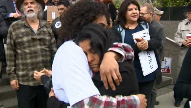 Monica Garcia and her son Jonathan Guerrero hug one another outside the federal courthouse in Sacramento.
