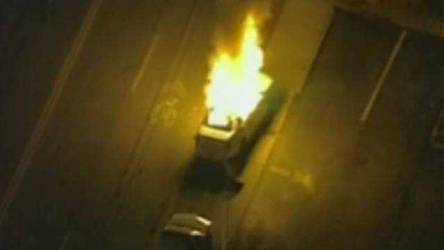 Live video shows a St. Louis County sheriff's deputy patrol car on fire.