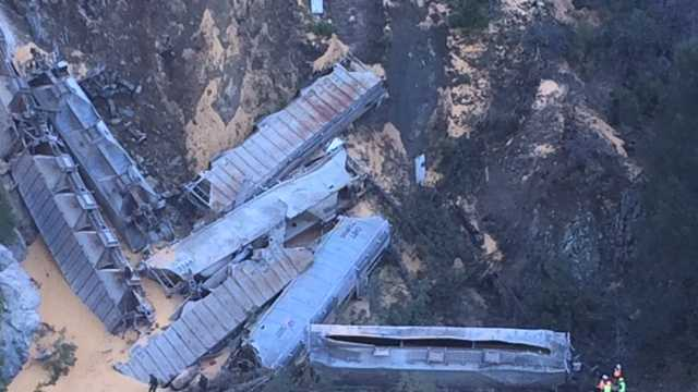 A train with 12 railroad cars filled with grains derailed Tuesday morning near Highway 70 in Plumas County. (Nov. 25, 2014)