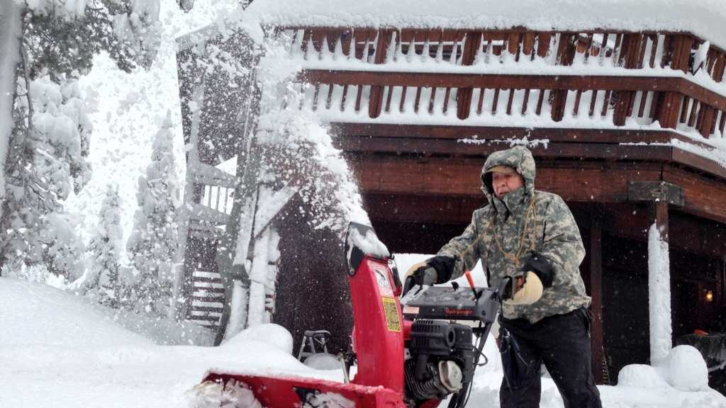 Bob Norgard of Serene Lake's clears his drive after two feet of snow fell Thursday and Friday.