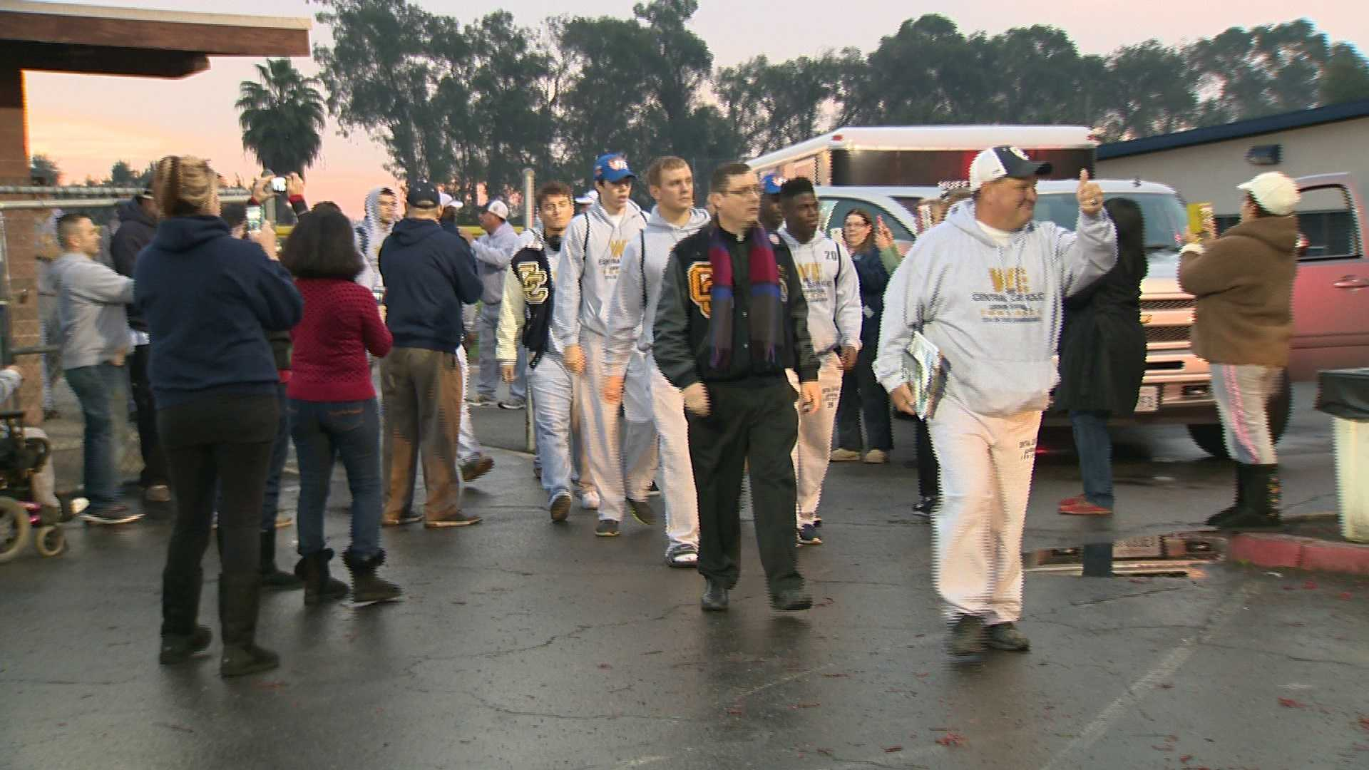 Central Catholic players and coaches loaded onto buses headed for Southern California early Thursday morning ahead of their CIF state championship game against St. Margaret's High School. (Dec. 18, 2014)