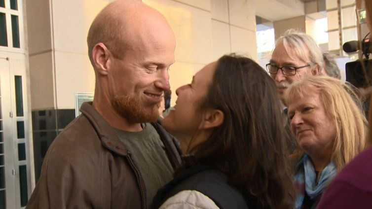 Eric McDavid is greeted by his girlfriend, Jenny Esquivel, following a judge's decision to overturn his eco-terrorism conviction.