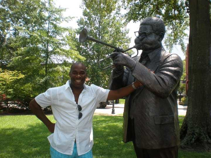 22.) I have family in Cheraw, South Carolina -- the birthplace of Dizzy Gillespie. Here I am in front of the statue in the Town Green on Market Street.