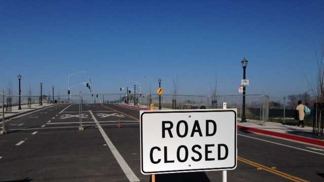 The city of Sacramento says it does not know when it will remove the road-closed signs from the recently completed streets into the downtown railyards development project.