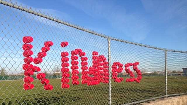 Red Solo cups are inserted on a fence at Rocklin Academy's Turnstone campus to spell out the theme of this week at their school.