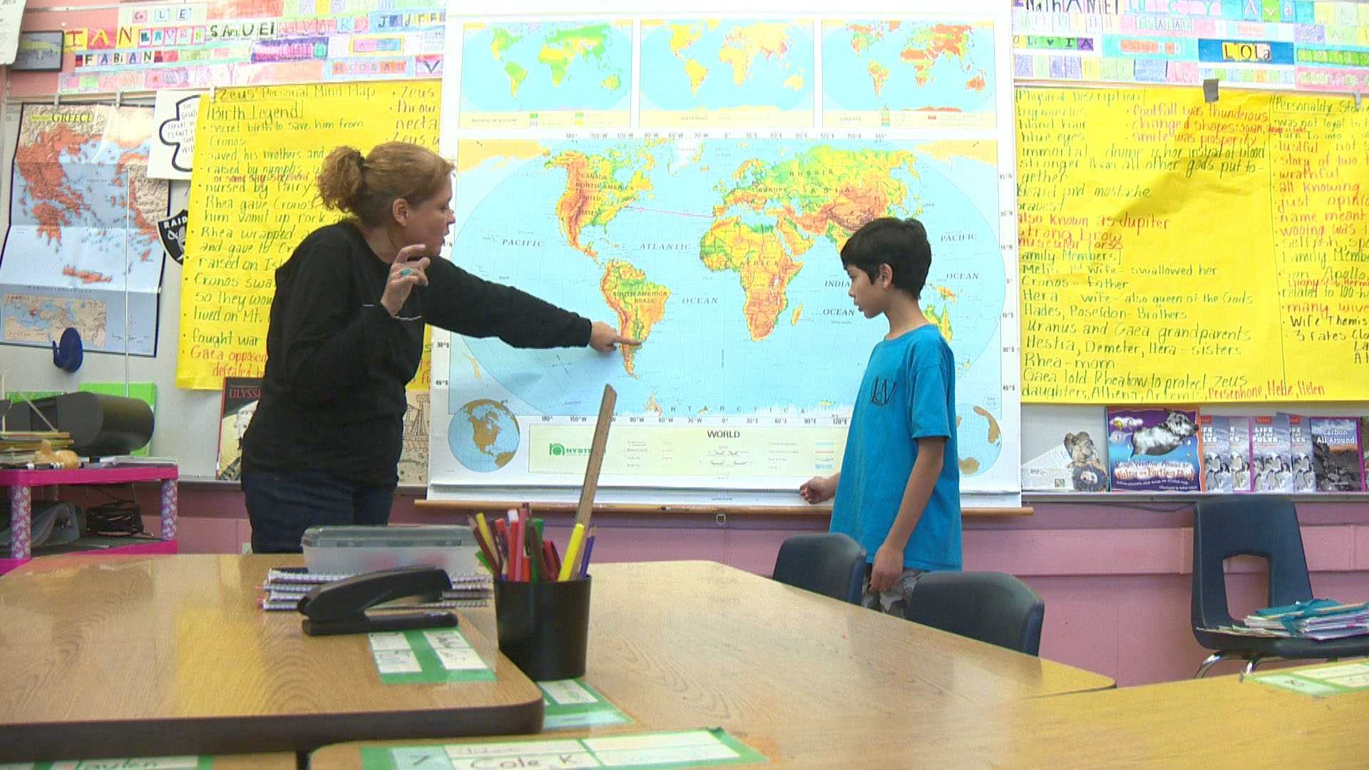 Kim Williams, a 6th-grade teacher at Leonardo DaVinci Elementary School in Sacramento, talks with her student, Aidan Fong, about their planned trip to Antarctica.