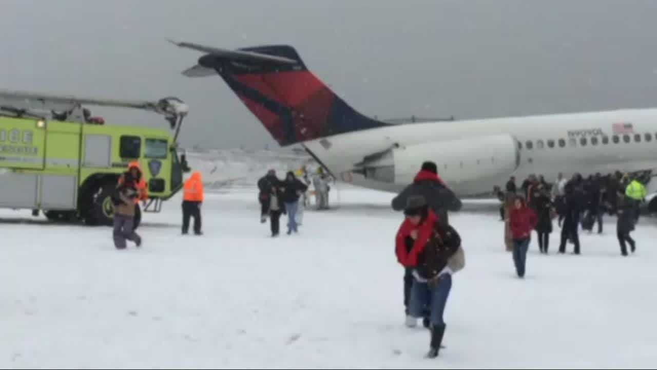 A passenger jet skidded off a snowy runway at New York's LaGuardia airport Thursday, shutting down one of the nation's busiest transit hubs.