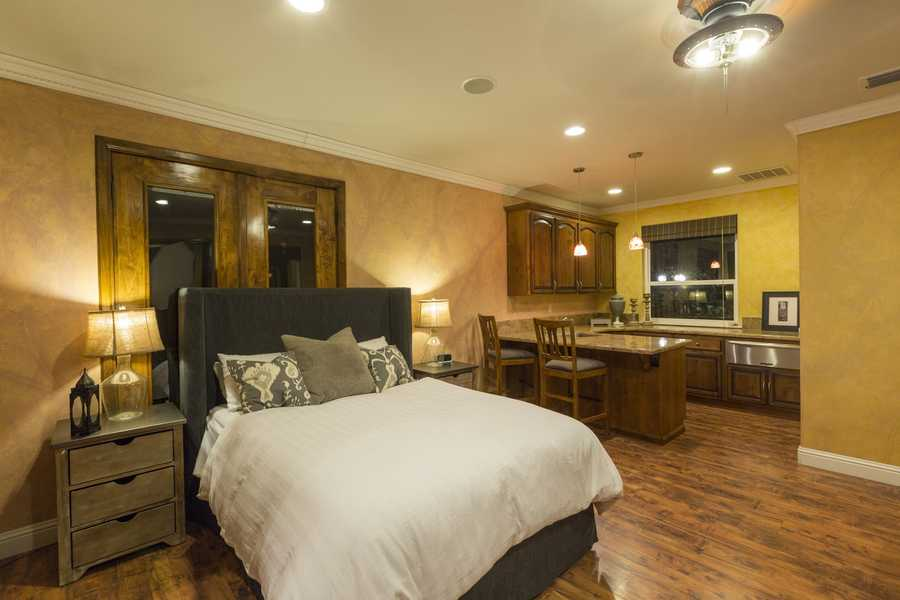 Hosting guests? The home offers this guest casita on first floor that has its own entrance and surround sound throughout.