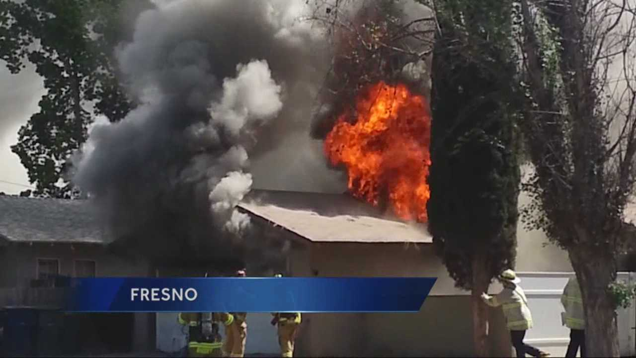 A Fresno firefighter was badly burned after he fell through the roof of a home while battling the blaze.