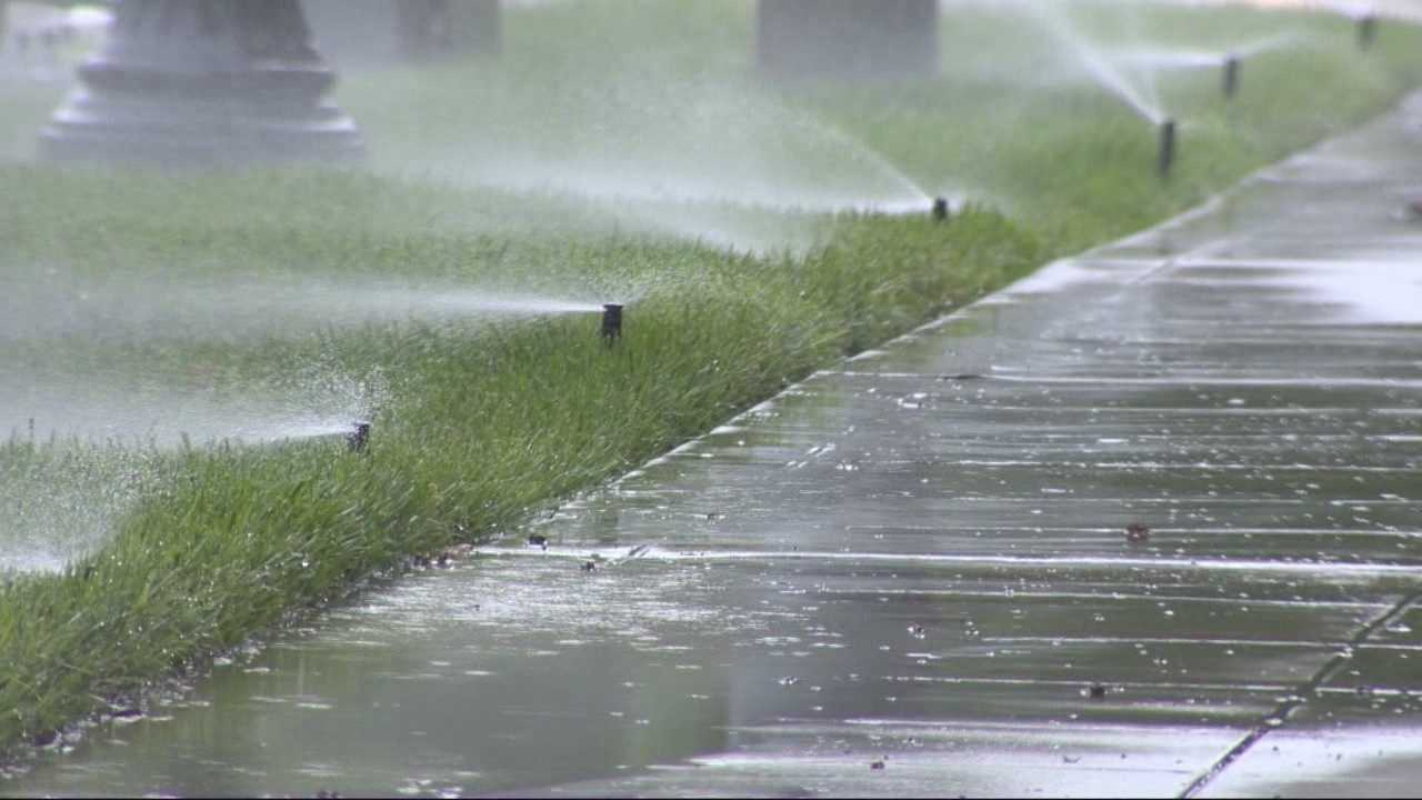 With the rain on Easter Sunday, new state rules prohibit watering within 48 hours of measurable rainfall. But the headquarters of one state agency has been watering non-stop.