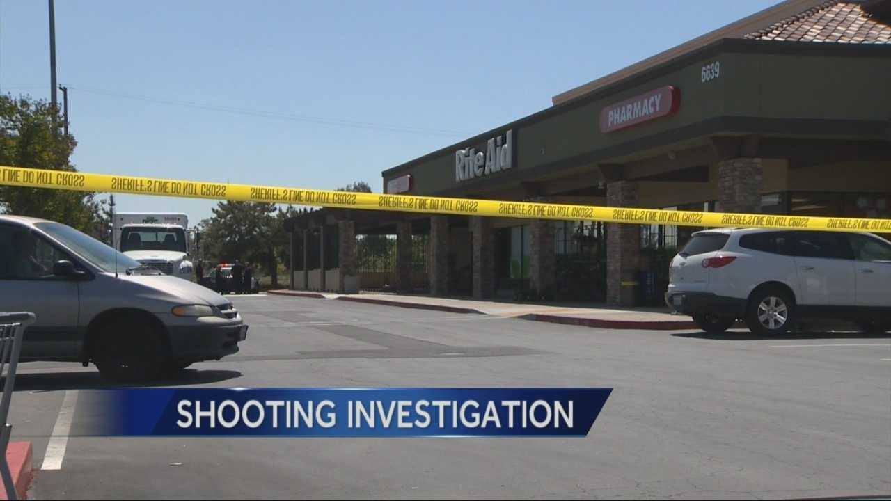 A man suspected of firing shots in the parking lot of a North Highlands shopping center is in custody after he was shot in the arm by Sacramento Counties Sheriff's deputies.