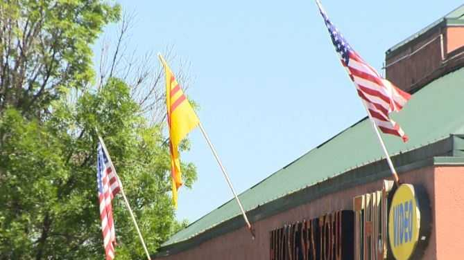 The flag of former South Vietnam flies among American flags in Sacramento's Little Saigon neighborhood.