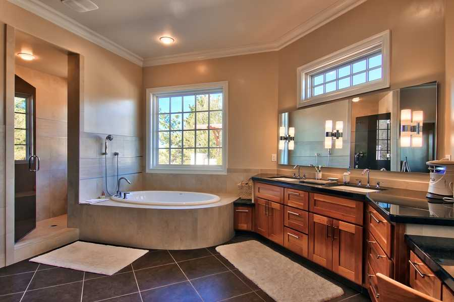 Here's a peek into one of the bathrooms and full bath. The home has four bedrooms and four bathrooms.