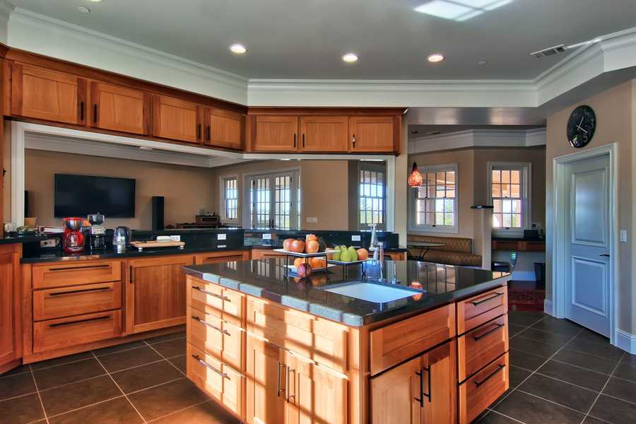 Here's a look inside the gourmet kitchen with a large island.