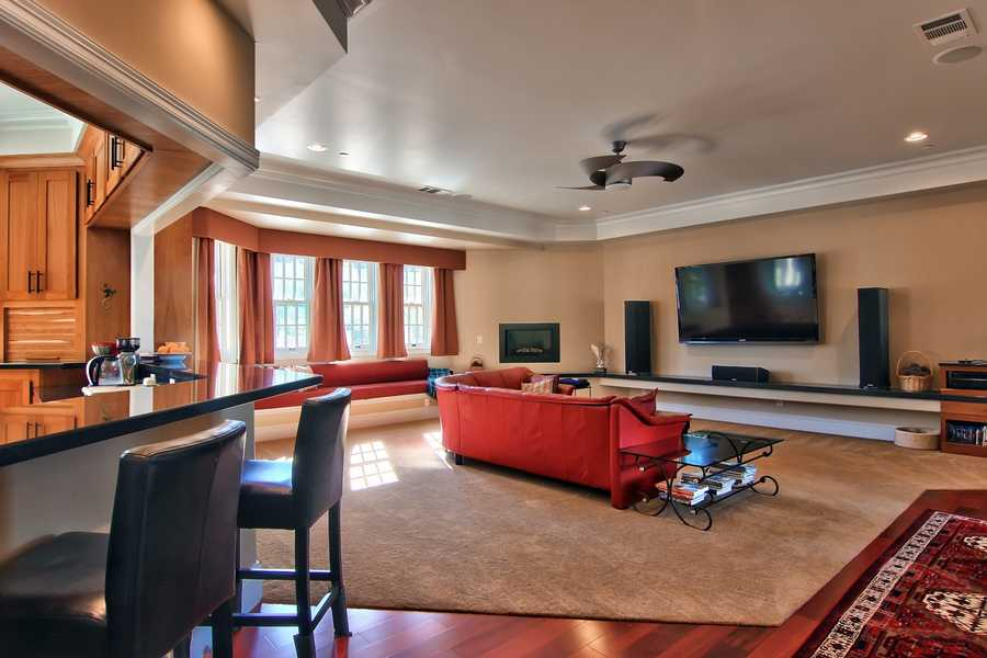 There are many upgrades throughout the home, including handcrafted cabinets, custom windows, coffered ceilings, built-in surround system, three fireplaces, intercom, and French doors.