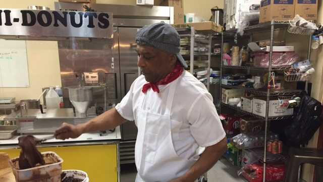 The owner of Danny's Mini Donuts mixes chocolate for the first-ever Chocolate Week in Old Sacramento.