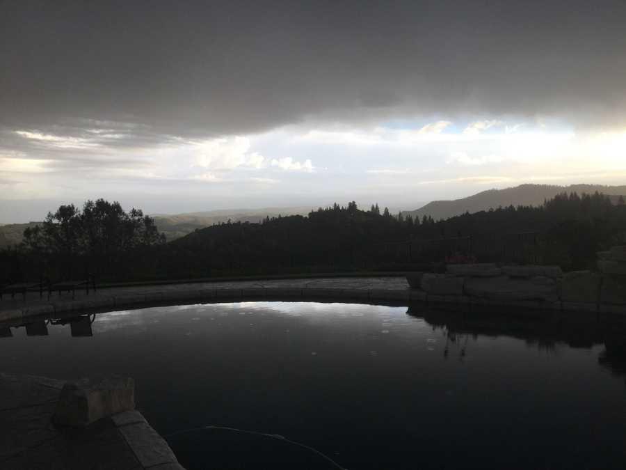 Rain drops begin to fall on a pool Thursday morning in El Dorado Hills. (May 7, 2015)