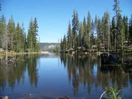 Try hiking up the ridge above Kingvale to the Cascade lakes. The south shore of Upper Cascade Lake is dominated by the 7,700-foot Devils Peak. Lower Cascade Lake shows off this nice cove with the rocks visible beneath the clear surface.