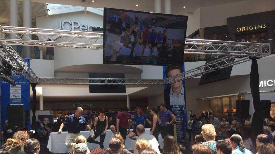 Teo Torres and Deirdre Fitzpatrick lead the crowd in tree pose at the Health and Wellness Festival at the Roseville Galleria.