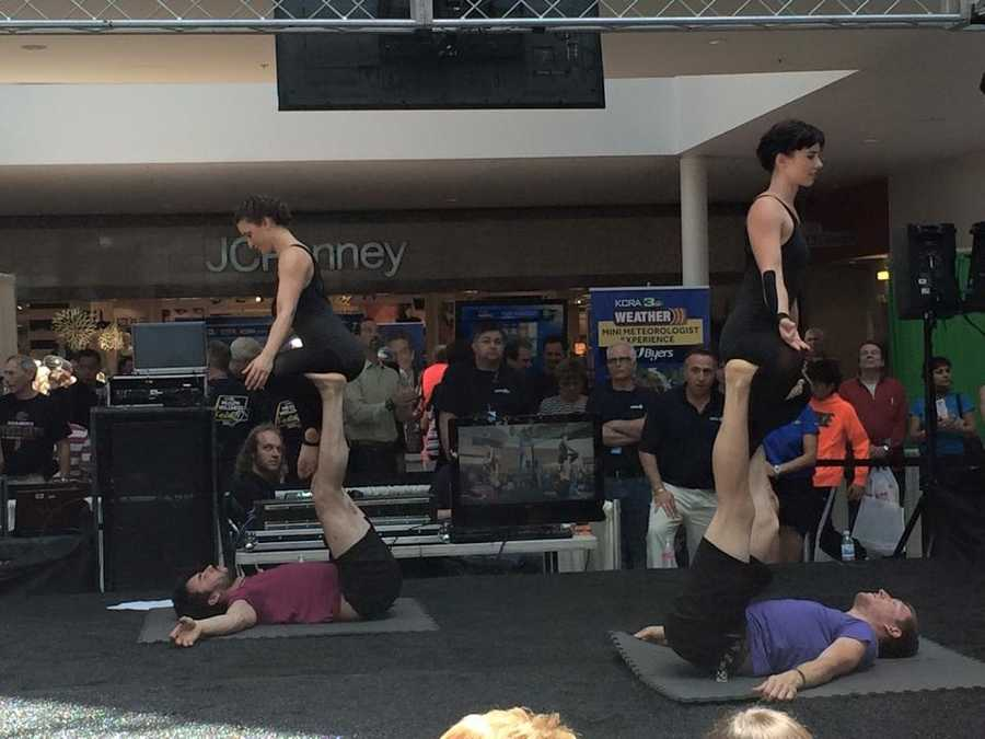 Festival-goers enjoy a gorgeous AcroYoga performance during the KRCA Health and Wellness Festival in Roseville.