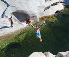 The beautiful swimming hole has clean, crystal-clear water.