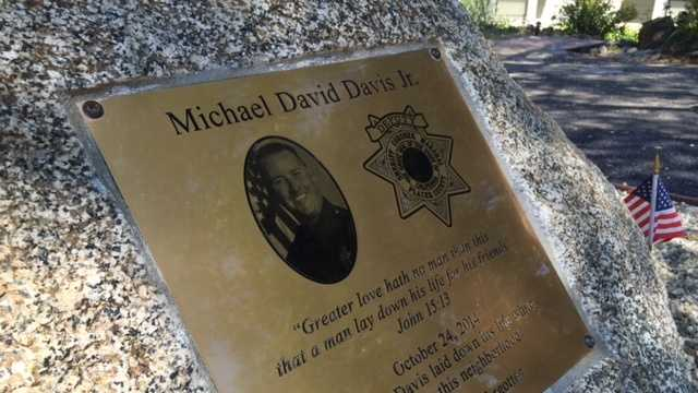 Neighbors on Riverview Drive in Auburn dedicated a memorial to Detective Mike Davis who was shot and killed on their street during a manhunt last October.