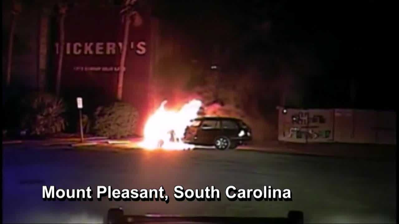 Dashcam video captured a South Carolina police officer pulling a man from a burning vehicle.