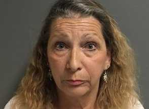 Christine Ann Cooper was taken into custody on charges of elder abuse/theft from an elder, embezzlement and forgery, according to the Placer County Sheriff's Department.