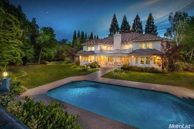 The 6,919-square-foot estate enjoys the privacy of Placer Canyon within a gated community.