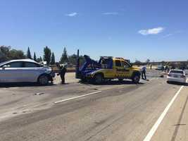 "Crews worked to clean up the ""massive crash scene"" on I-80 near Highway 50 in West Sacramento as the westbound lanes remained closed. (June 16, 2015)"