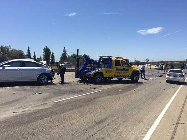 """Crews worked to clean up the """"massive crash scene"""" on I-80 near Highway 50 in West Sacramento as the westbound lanes remained closed. (June 16, 2015)"""