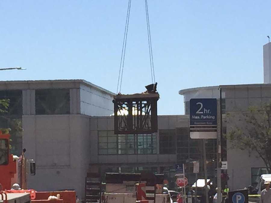 A photo of the collapsed balcony being lowered to the ground for inspection. (June 16, 2015)